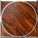 sol-style-essence-style-exotique-parquet-propose-bois-brun-nuances-rond-courbes-noeud