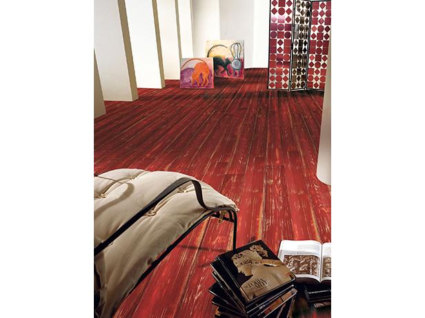 sol-et-style-projet-categorie-maisons-style-design-salon-fauteuil-livres-sol-rouge